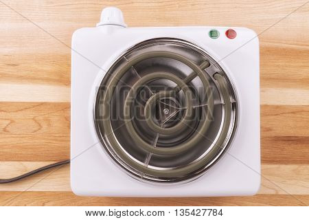 Electric portable stove on a heating element