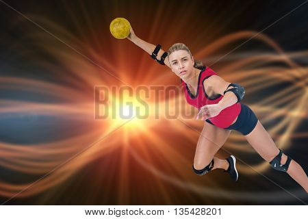 Female athlete throwing handball against composite image of orange spotlight
