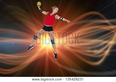 Female athlete with elbow pad throwing handball against composite image of orange spotlight