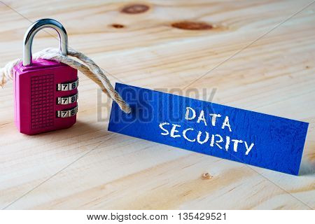 Words Data Security Written On Tag Label Tied With A Padlock.
