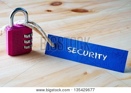 Words Security Written On Tag Label Tied With A Padlock.
