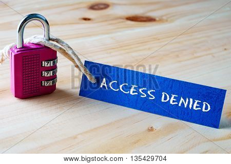 Words Access Denied Written On Tag Label Tied With A Padlock.