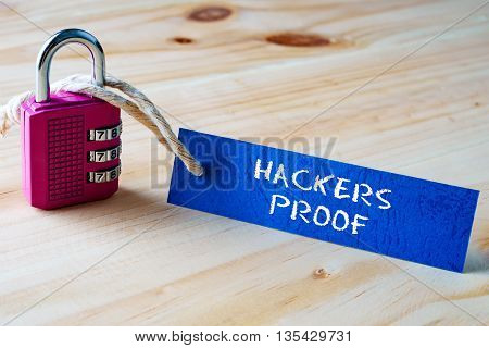 Words Hackers Proof Written On Tag Label Tied With A Padlock.