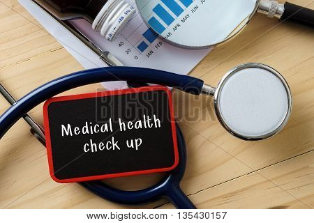 Medical Conceptual.stethoscope On Wooden Table With Word Medical Health Check Up.