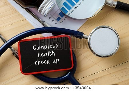 Medical Conceptual.stethoscope On Wooden Table With Word Complete Health Check Up.