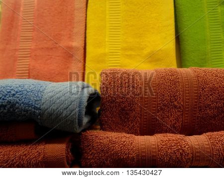 Stacks of folded colored terry towels closeup