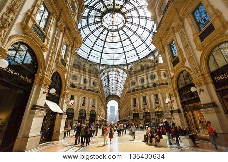 Milan Italy - May 04 2016: Some people walks by the Gallery Emanuele Vittorio famous shopping mall of Europe