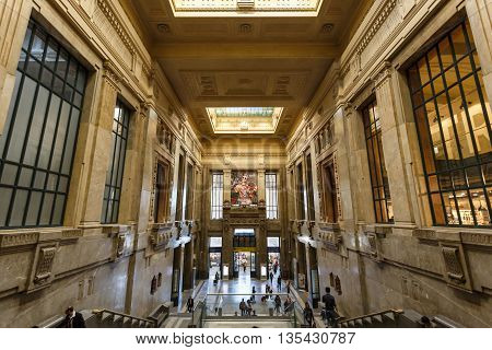 Milan Italy - May 04 2016: Traveling people inside the building of Central Railway Station