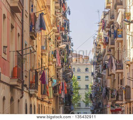 Narrow street with balconies in Spain, Iveta bright yellow walls