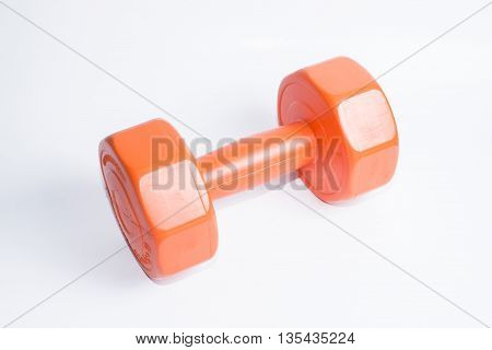 A orange dumbbell to exercise for healthy