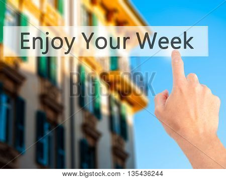 Enjoy Your Week - Hand Pressing A Button On Blurred Background Concept On Visual Screen.