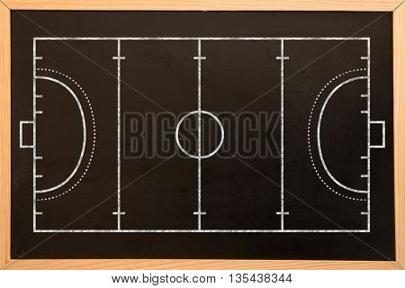 Handball field plan on a black background against blackboard with copy space