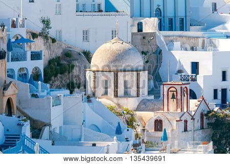 View of the Greek Christian church with a cross in the town Fira. Santorini. Greece.