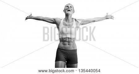 Fit woman celebrating victory with arms stretched against white background