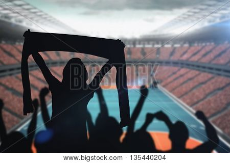 Silhouettes of football supporters against drawing of sports field