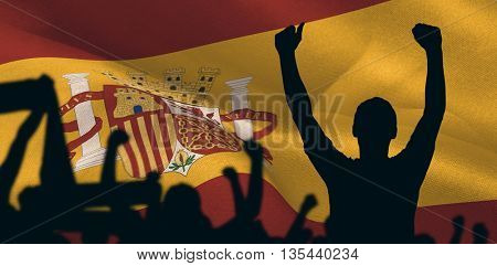 Silhouettes of football supporters against digitally generated spain national flag