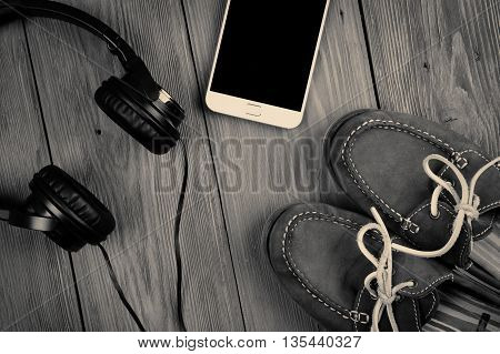 Phablet And Headphones On The Wooden Desk