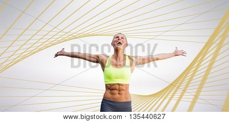 Fit woman celebrating victory with arms stretched against blue angular design