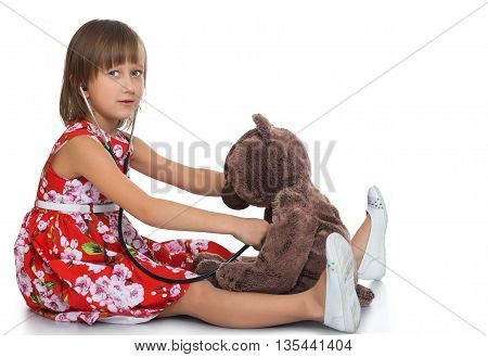Girl playing in the hospital with a Teddy bear - Isolated on white background