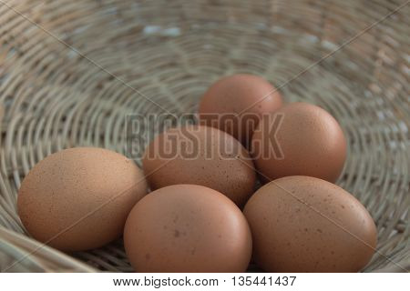 Six eggs in the basket close up.