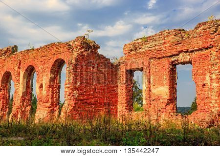 Ruin of abandoned house with red brickwork