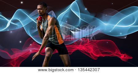 Athlete man concentrating during his shot put against blue wave