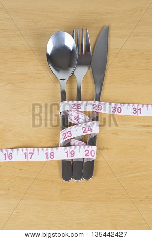 cutlery with tape measure healthy lifestyle concept