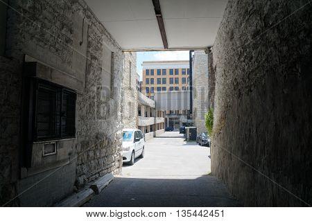 JOLIET, ILLINOIS / UNITED STATES - JUNE 3, 2015: A narrow alley between buildings in downtown Joliet.