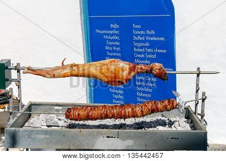 Carcass lamb grilled on a spit. Santorini. Greece