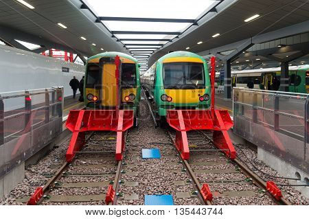 LONDON ENGLAND - OCTOBER 21: Trains at a platform on London Bridge station. In terms of passenger arrivals and departures it is the fourth-busiest station in London as well as the United Kingdom as a whole handling over 54 million customers a year.