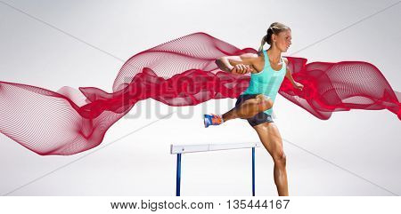 Sportswoman practising the hurdles against blue design