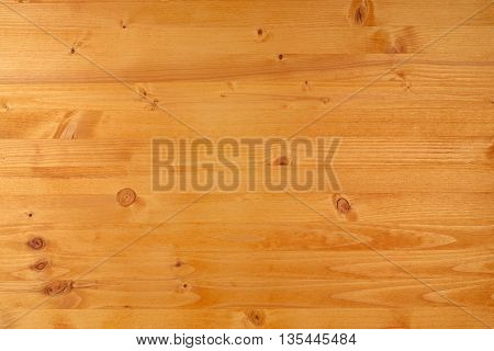 Yellow pine wood plank texture top view of wooden board