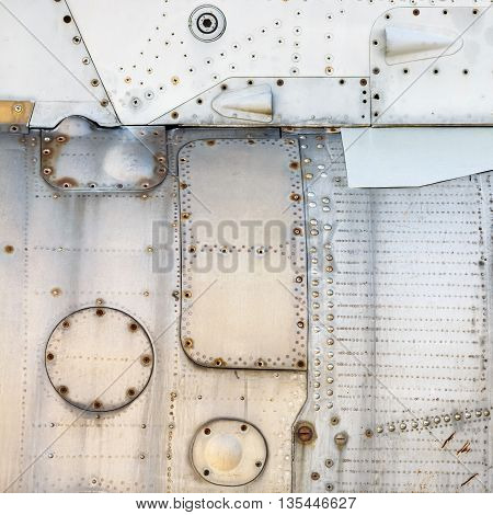 Metal texture with rivets. Weathered metallic background. Old metal background. Sheathing old airplane.