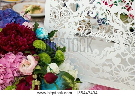 white and purple flowers wedding accessories wedding preparation decorated wedding table with flowers wedding flowers food on the table decorated chairsglasses fruit grapes salad on the table