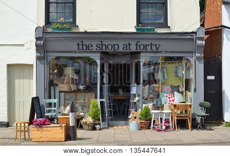 St Neots, Cambridgeshire, England - June 21, 2016: Store front of The Shop at Forty which sells Retro and Vintage wares with stock outside on the pavement.