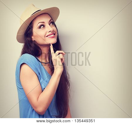 Happy Casual Fun Woman In Summer Hat And Blue Top Thinking And Looking Up. Toned Portrait