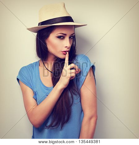 Beautiful Makeup Female Model In Summer Casual Hat Showing Secret Sign. Vintage Toned Portrait