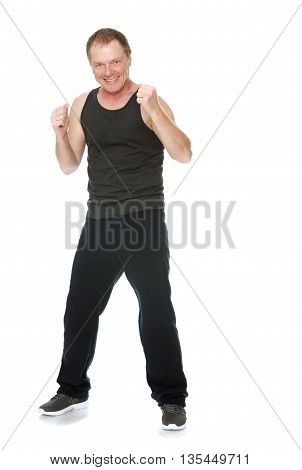 A fifty year old man in a track suit took a boxer's stance-Isolated on white background