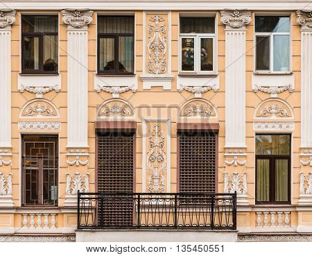 St. Petersburg Russia - May 16 2016: Several windows in a row and balcony on facade of urban apartment building front view