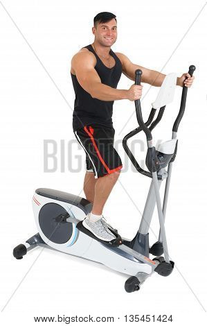 young man doing exercises with elliptical cross trainer, isolated on white background