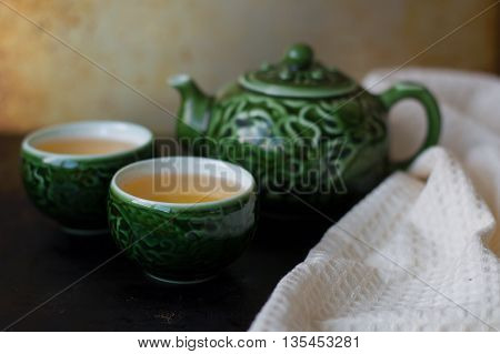 Chinese tea set for traditional tea ceremony two small cups teapot and white towel