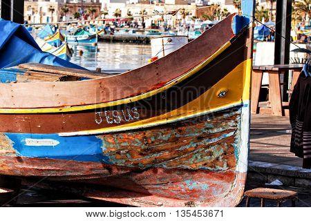 Maltese luzzu, traditional fishing boat in Malta, multi colored