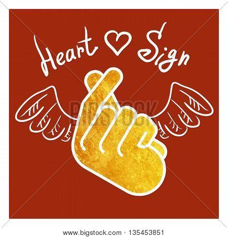 The hand folded into a heart symbol.