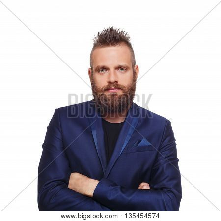 Young bearded man isolated at white background. Close up portrait of a confident guy with beard looking at camera. Boy style, trendy hipster look with cool hairstyle in blue suit. Modern businessman.