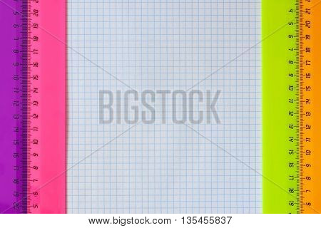 Set of multiple plastic rulers on a white background of exercise book close up, With your place for the text
