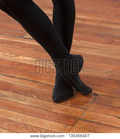 Low Section Of Ballet Trainer Performing On Floor