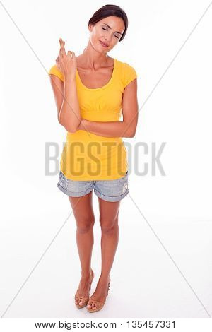 Wishing Brunette Woman With Fingers Crossed