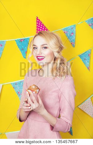 Beautiful Smiling Young Blonde Woman With A Cake. Celebration And Party.colorful Studio Portrait Wit