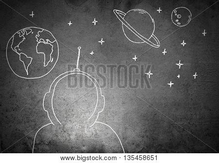 Empty astronaut suit drawn on concrete background