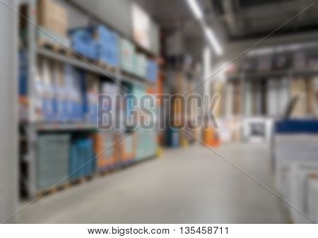 Aisle with shelves in construction market defocused.